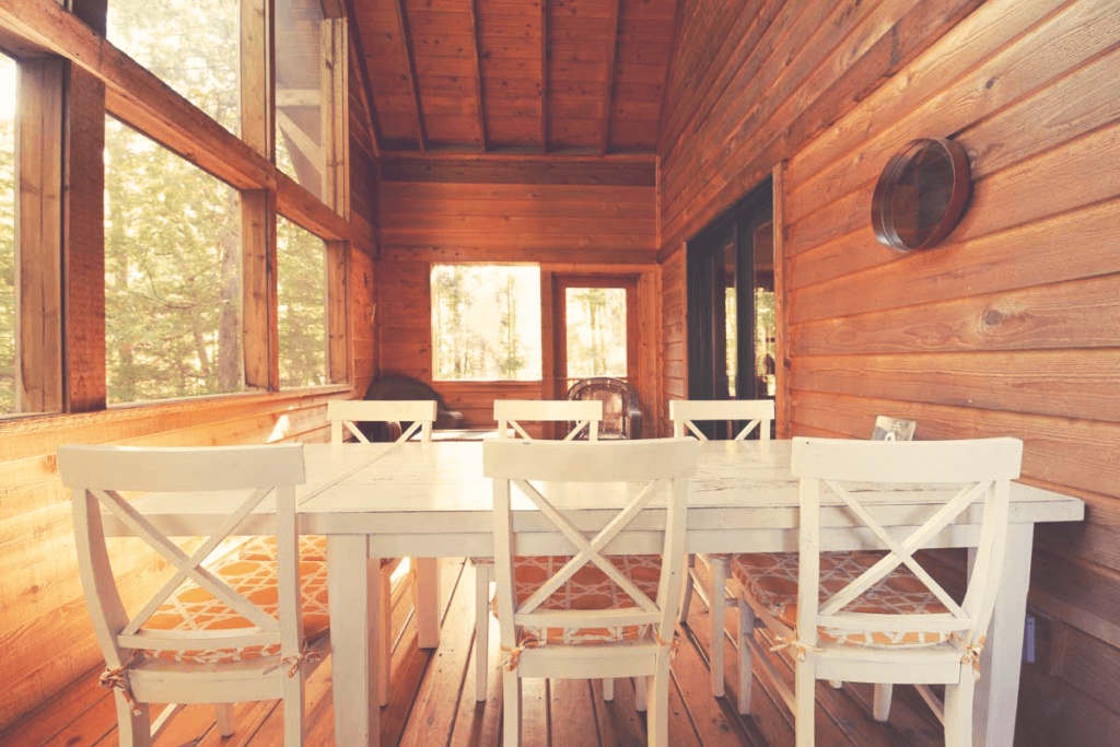 Family table on screened porch in an Apostle Islands cabin rental in Bayfield Wisconsin
