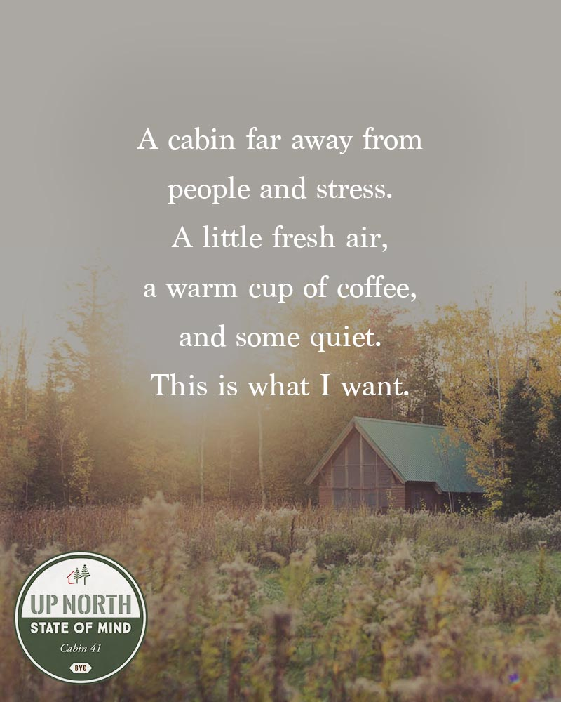 """Bayfield Wisconsin cabin sitting in a field of grass in the warmth of the sun with the following quote written overtop, """"A cabin far away from people and stress. A little fresh air, a warm cup of coffee, and some quiet. This is what I want."""""""